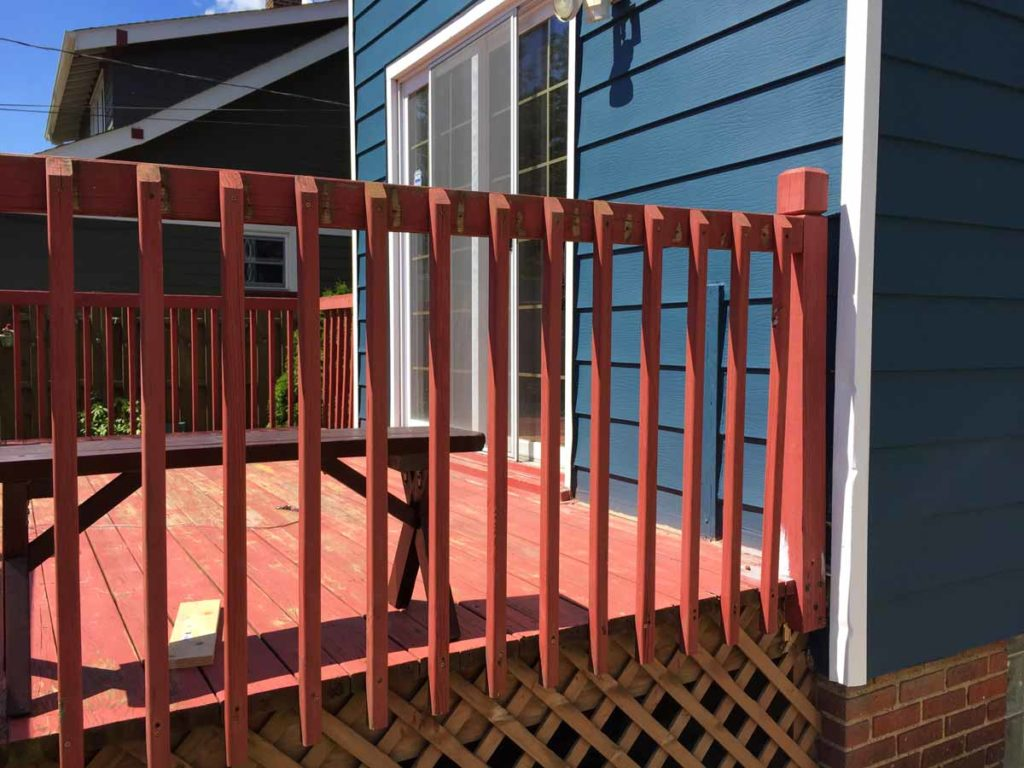 Level, evenly spaced pickets on a deck railing