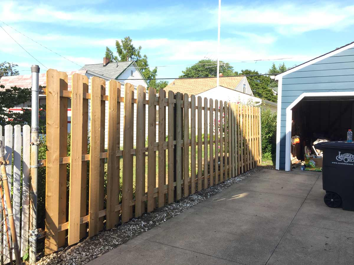 converting a four foot chainlink fence to a six foot wood fence