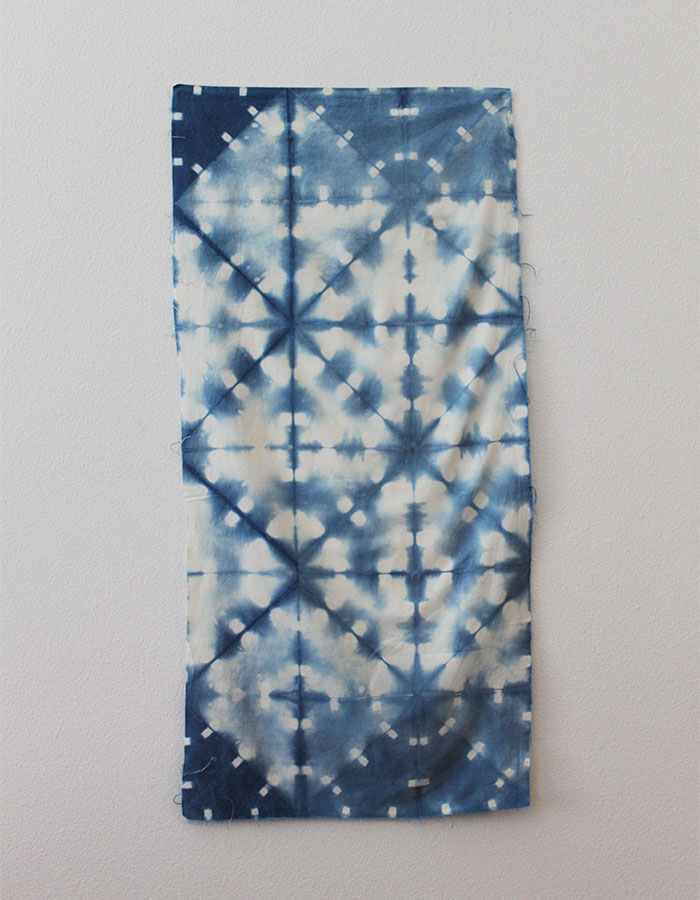 shibori folding patterns clothespins