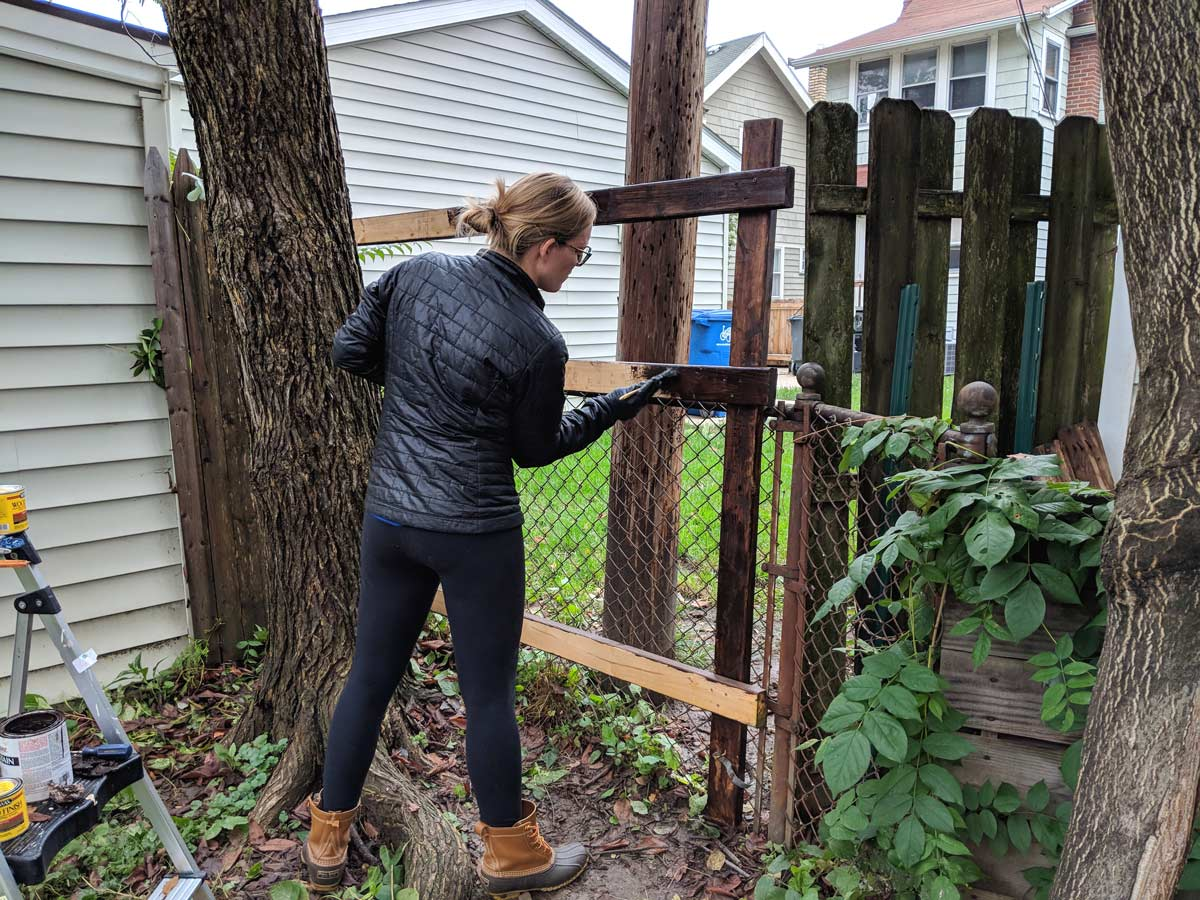 Attaching A Wood Fence To A Chainlink Fence And Then We